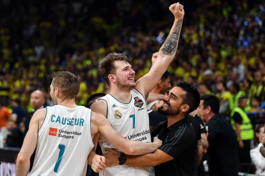 TOPSHOT - Real Madrid's Slovenian Luka Doncic (R) celebrates with team mate Real Madrid's French forward Fabien Causeur their team's 85-80 win in the Euroleague Final Four finals basketball match between Real Madrid and Fenerbahce Dogus Istanbul at The Stark Arena in Belgrade on May 20, 2018. / AFP PHOTO / Andrej ISAKOVICANDREJ ISAKOVIC/AFP/Getty Images
