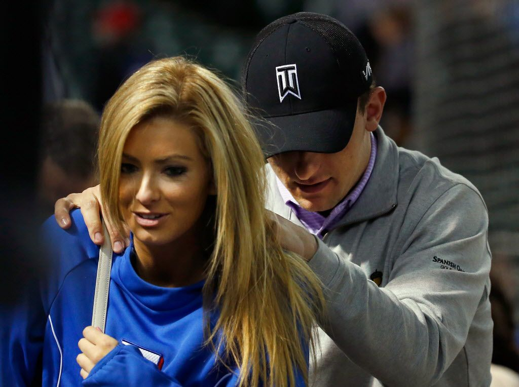 ARLINGTON, TX - APRIL 14:  Johnny Manziel quarterback of the Cleveland Browns exits the stands after the Texas Rangers beat the Los Angeles Angels 8-2 at Globe Life Park in Arlington on April 14, 2015 in Arlington, Texas.  (Photo by Tom Pennington/Getty Images)