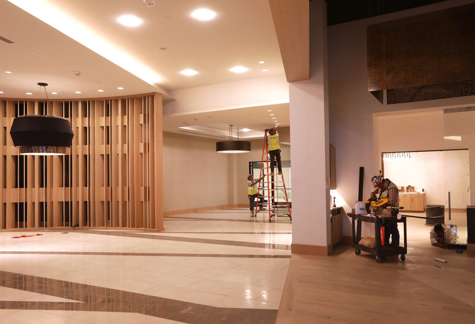 Workers put the finishing touches on the lobby and dining area of the Frisco Hyatt Regency.