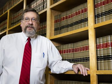 Dallas County Chief Staff Attorney Kerry Young, in his office at the Frank Crowley Criminal Courts building in Dallas, is retiring after 40 years advising judges. He has seen all the biggest cases that have gone through the county's courts over the past four decades.