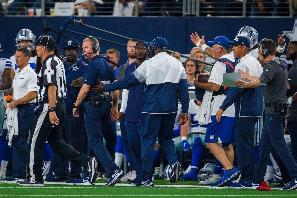 Dallas Cowboys head coach Jason Garrett glares as field judge Scott Edwards (3) after Garrett was penalized after throwing the red challenge flag (bottom left) during the second half of an NFL football game against the Green Bay Packers at AT&T Stadium on Sunday, Oct. 6, 2019, in Arlington.