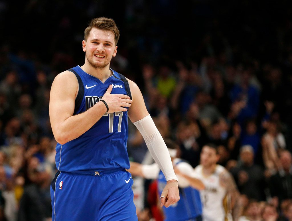 Dallas Mavericks guard Luka Doncic (77) taps his chest after making a three pointer late in overtime play over New Orleans Pelicans center Derrick Favors (22) at American Airlines Center in Dallas on Wednesday, March 4, 2020. Dallas Mavericks defeated the New Orleans Pelicans 127-123.