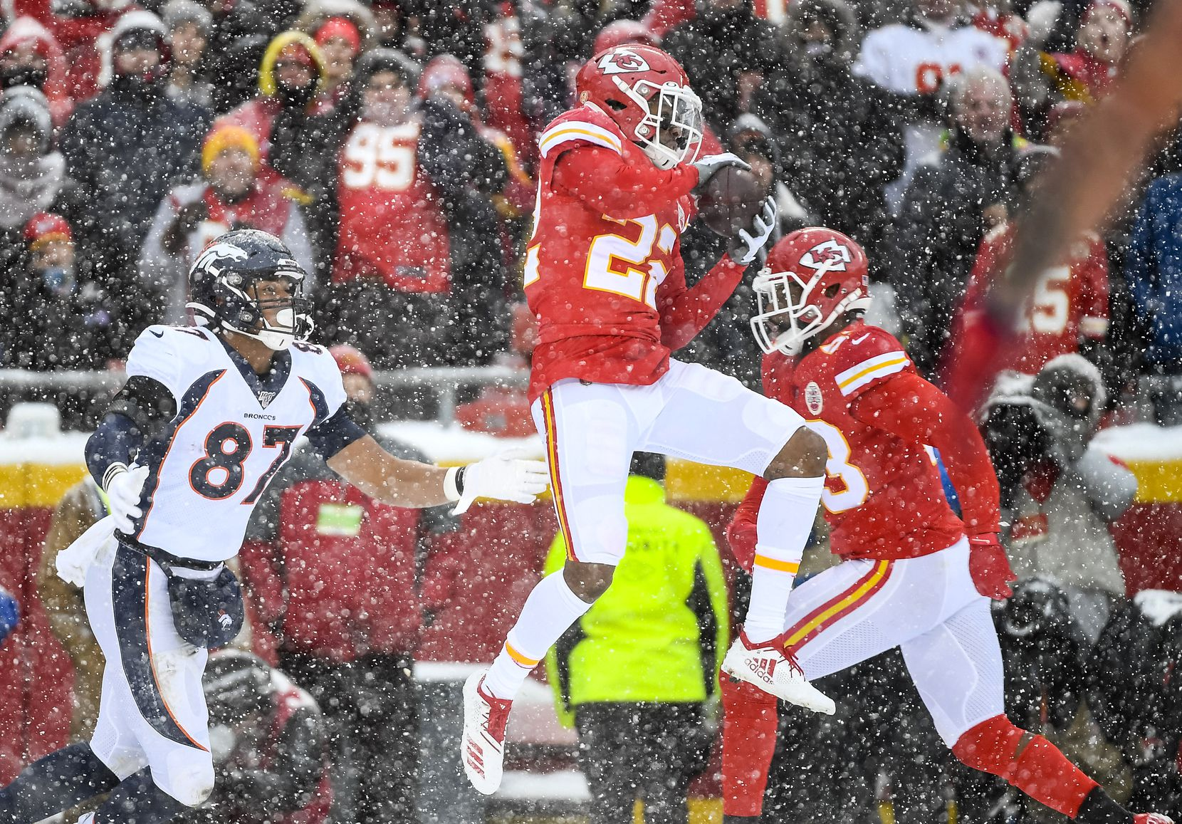 Chiefs free safety Juan Thornhill (22) intercepts a ball intended for Broncos tight end Noah Fant (87) during the second half of a game in Kansas City, Mo., on Sunday, Dec. 15, 2019. (AP Photo/Reed Hoffmann)