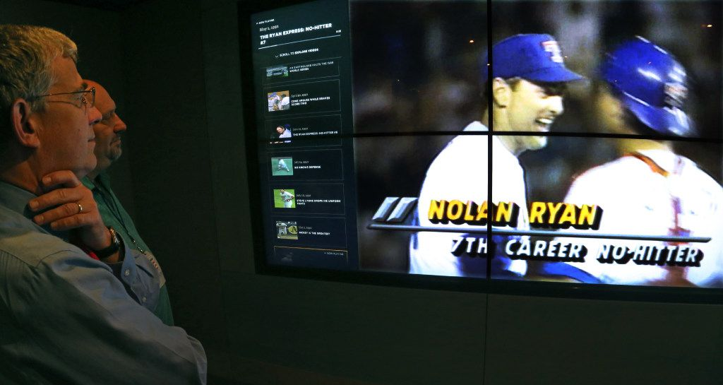 Baseball Hall of Fame Curator John Odell and DMN baseball writer Evan Grant watch a video highlight of Nolan Ryan's seventh no-hitter at the Baseball Hall of Fame in Cooperstown, NY, photographed on Tuesday, May 30, 2017. (Louis DeLuca/The Dallas Morning News)