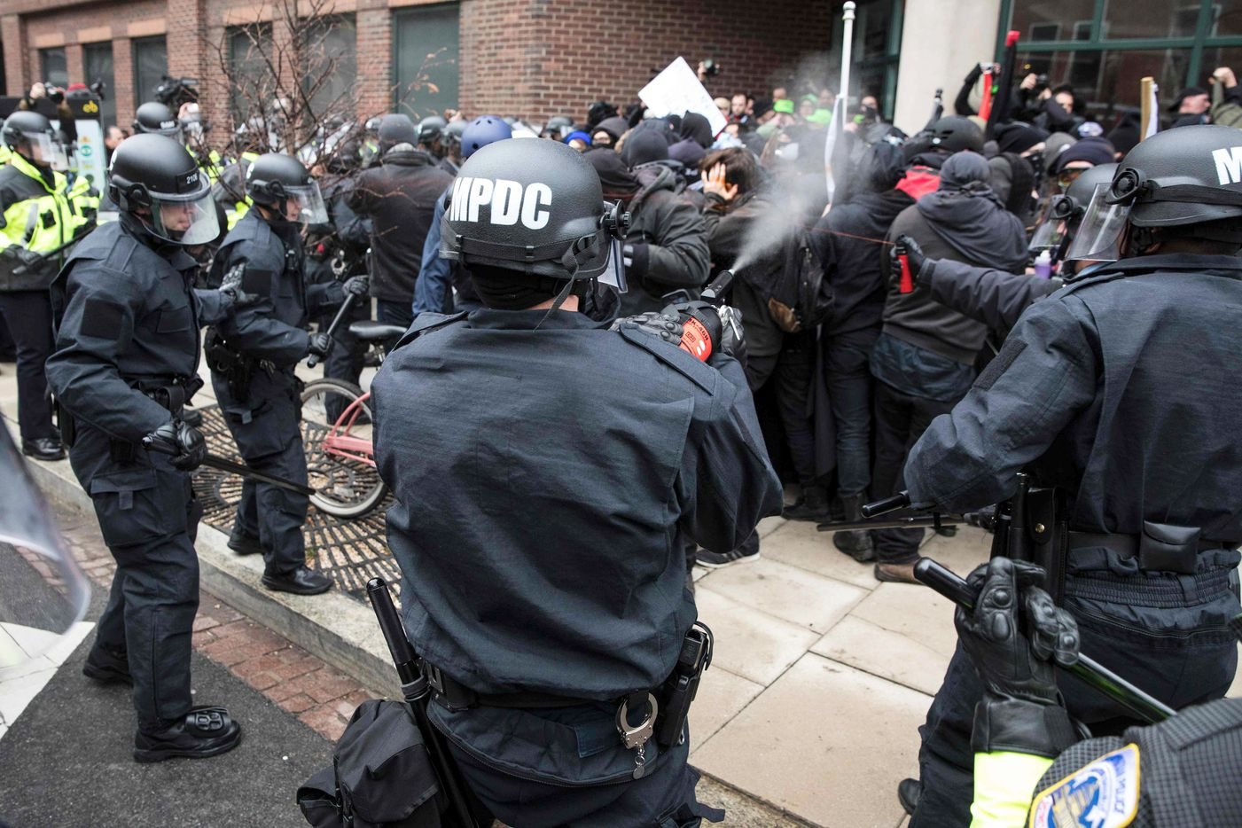 Police officers pepper spray a group of protestors before the inauguration of President-elect Donald Trump January 20, 2017 in Washington, DC.     Donald Trump was sworn in as the 45th president of the United States Friday -- capping his improbable journey to the White House and beginning a four-year term that promises to shake up Washington and the world.