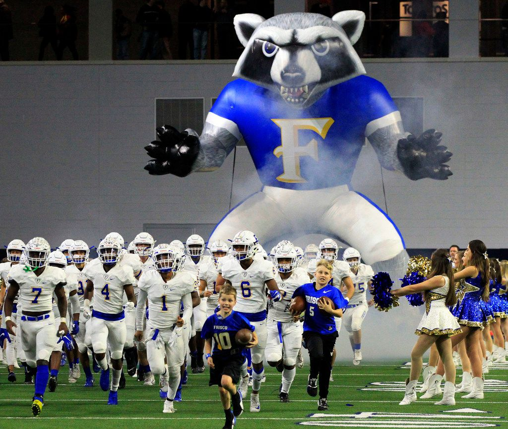 The Frisco team comes onto the field through the team's giant Raccoon blowup tunnel before the start of their high school playoff football game against South Oak Cliff at the Star on Friday, November 22, 2019. (John F. Rhodes / Special Contributor)