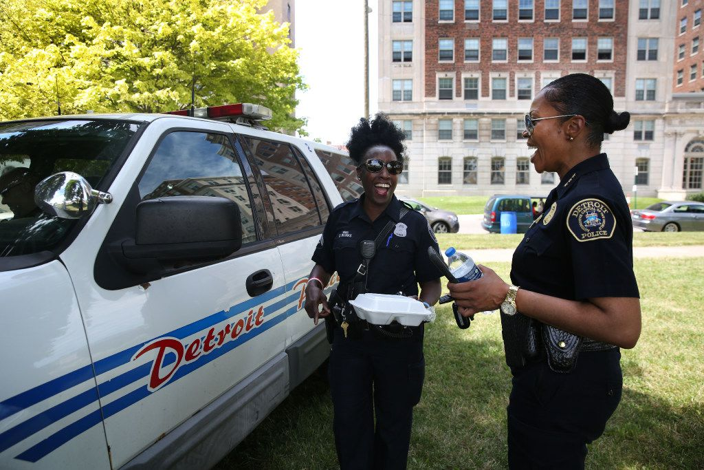 Neighborhood Police Officer C. Burks-Weathers (left) chats with Hall during the 8th Annual Senior Citizen Informational Summit at a Detroit park.