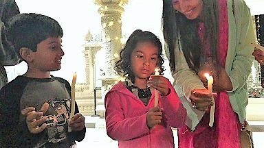 Children participate in the Candlelight Circle of Gratitude at Radha Krishna Temple in Allen.