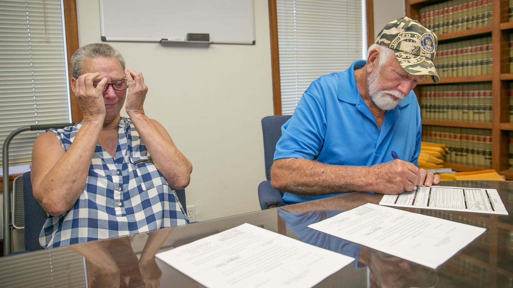 Fran  and Dan Keller look over court document declaring them innocent of the alleged sexual abuse of children in their South Austin day care center in 1991.