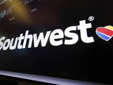 The logo for Southwest Airlines appears above a trading post on the floor of the New York Stock Exchange.