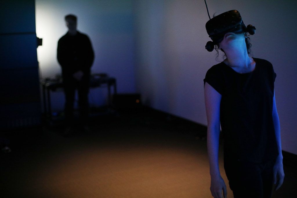 Student Tara Baker interacts with a virtual reality piece at the University of North Texas developed by David Stout