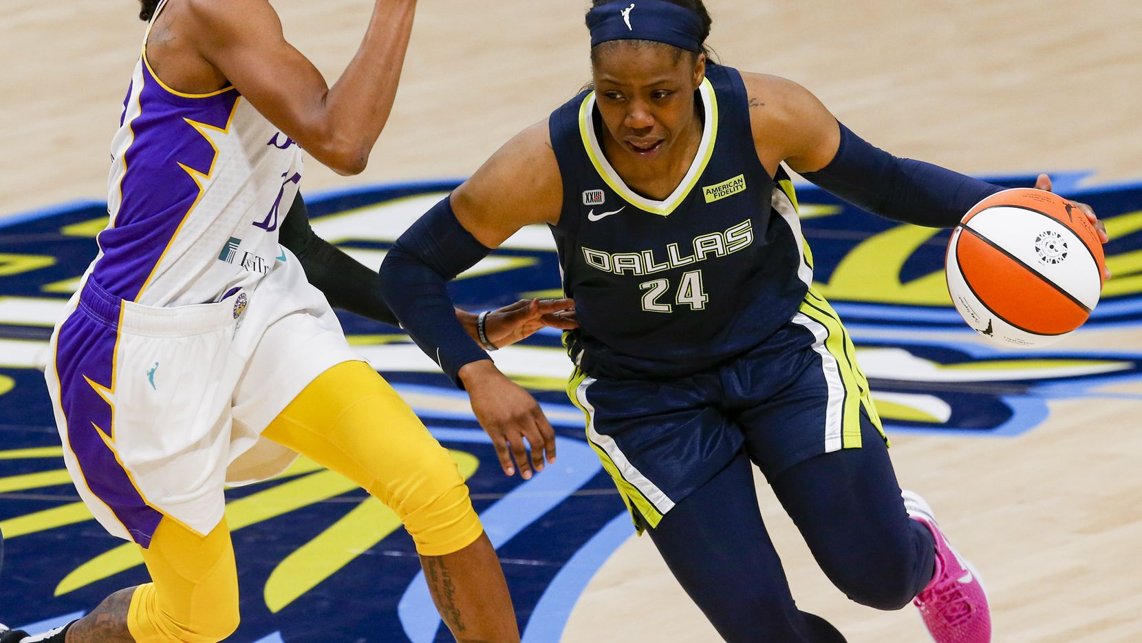 Dallas Wings guard Arike Ogunbowale (24) dribbles past Los Angeles Sparks guard Brittney Sykes (15) during the first quarter at College Park Center on Tuesday, June 1, 2021, in Arlington.