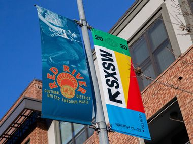 SXSW 2020 banners are seen in Austin on March 6, 2020 in Austin Texas. SXSW announced Tuesday that it will launch online programming as part of its 2021 event, while the possibility of in-person activities remains up in the air.