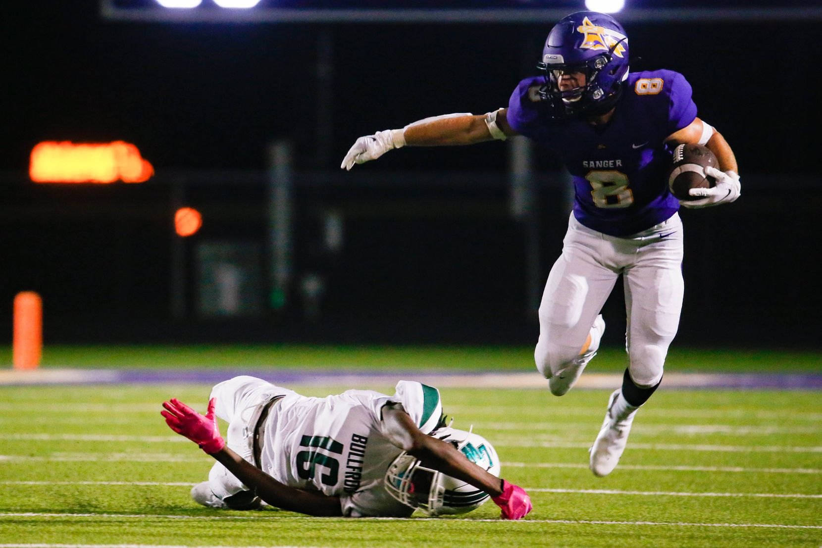 Sanger High School player Zach Shepard (8) jumps to avoid Lake Worth High School's Craig Williams (16) during the second half of a game on Sept. 4, 2020 in Sanger. Sanger won 49-35. (Juan Figueroa/ The Dallas Morning News)