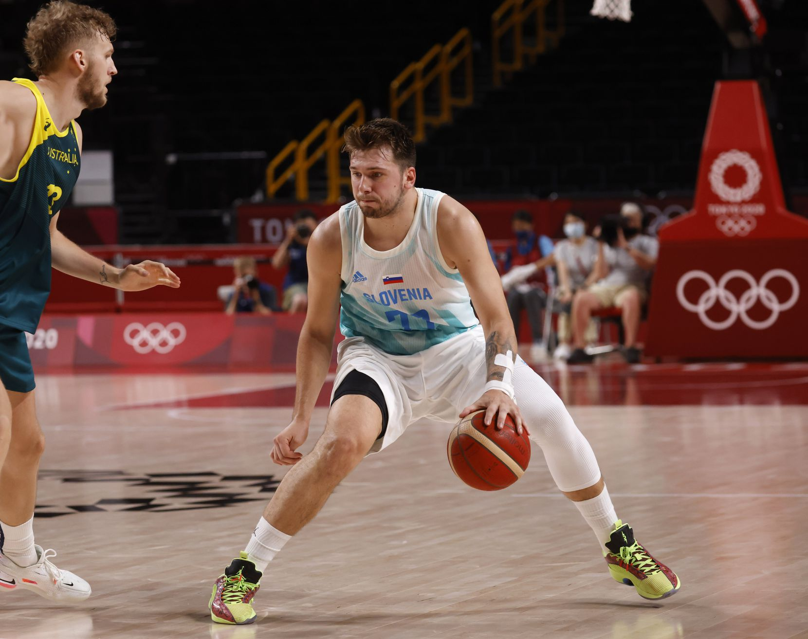 Slovenia's Luka Doncic (77) dribbles in front of Australia's Jock Landale (13) during the second quarter of play in the bronze medal basketball game at the postponed 2020 Tokyo Olympics at Saitama Super Arena, on Saturday, August 7, 2021, in Saitama, Japan. (Vernon Bryant/The Dallas Morning News)