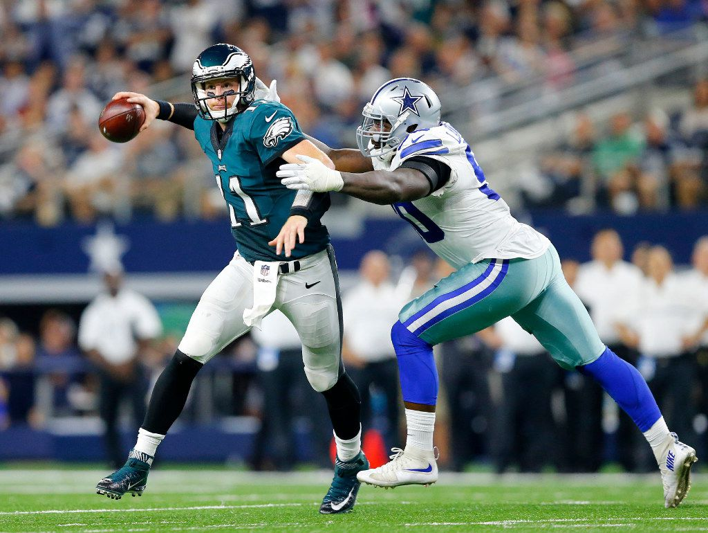 Dallas Cowboys defensive end Demarcus Lawrence (90) almost gets the sack of Philadelphia Eagles quarterback Carson Wentz (11) in the fourth quarter at AT&T Stadium in Arlington, Texas, Sunday, October 30, 2016. The Cowboys won, 29-23.