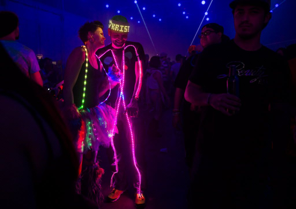 Kristi and Greg Sowell of College Station, Texas share a moment together during the Lights All Night New Year's Eve party on Thursday, December 31, 2015 at Dallas Market Hall in Dallas.