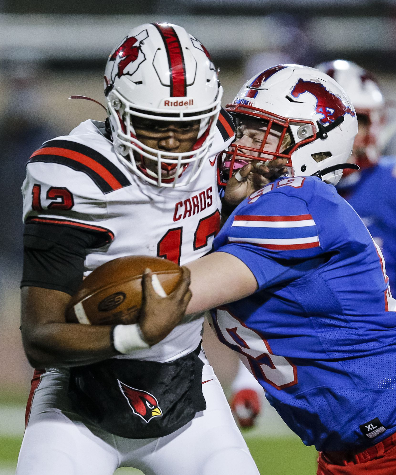 JJ Pearce senior defensive lineman Nicky Pacione (99) sacks Irving MacArthur sophomore quarterback Kylale Flye (12) during the first half of a high school playoff football game at Eagle-Mustang Stadium in Richardson, Thursday, December 3, 2020. (Brandon Wade/Special Contributor)