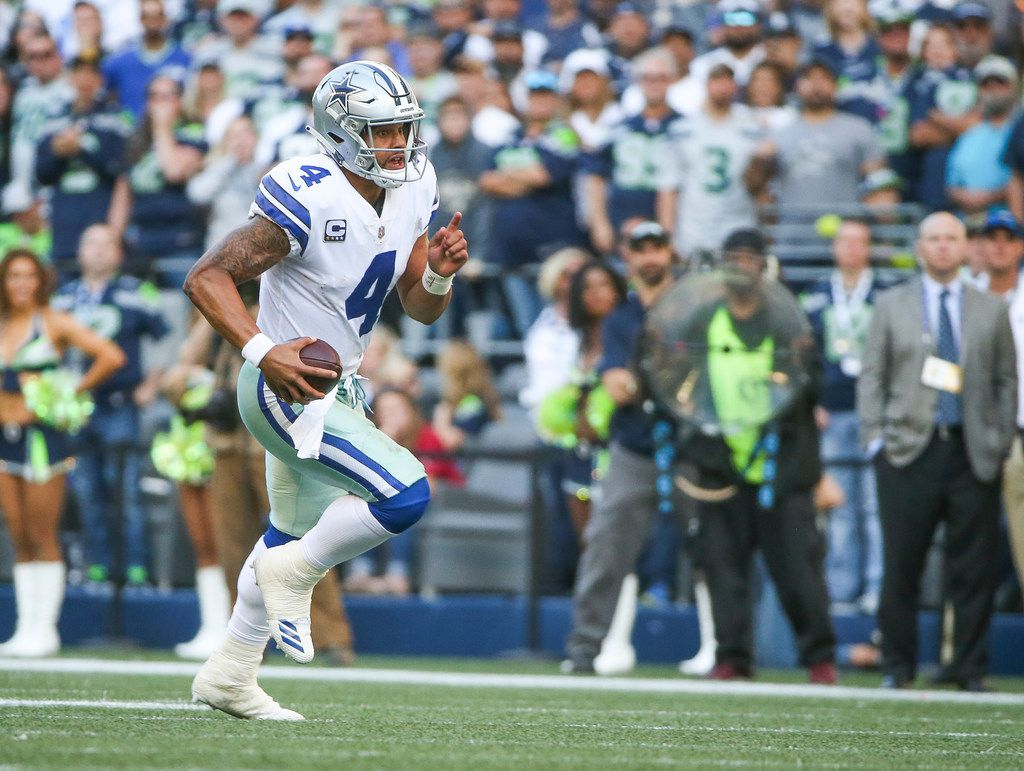 Dallas Cowboys quarterback Dak Prescott (4) carries the ball during the second half of an NFL game between the Dallas Cowboys and Seattle Seahawks on Sunday, September 23, 2018 at CenturyLink Field in Seattle. (Shaban Athuman/The Dallas Morning News)