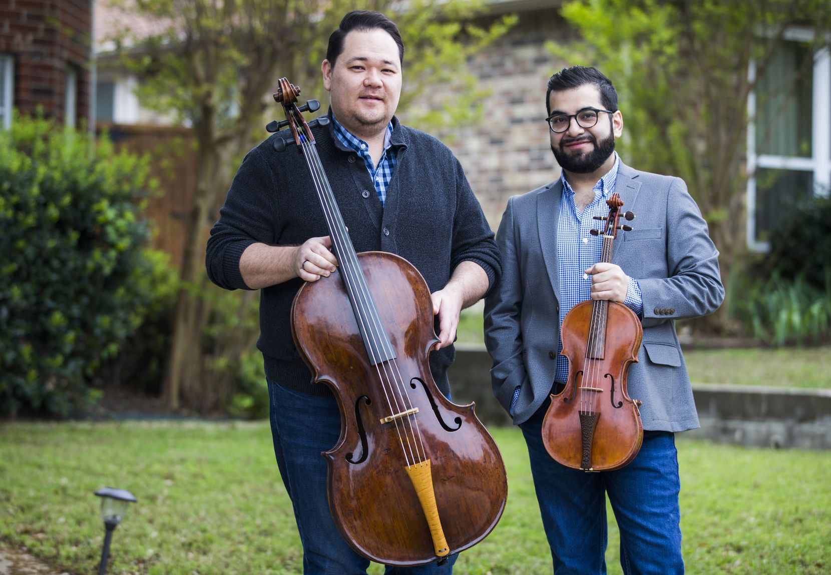 Freelance musician Eric Smith (left) and Miguel Cantú IV have lost most of their primary income because of the pandemic. The couple, who live in Plano, say they are uninsured. Cantú started work at Central Market this week.