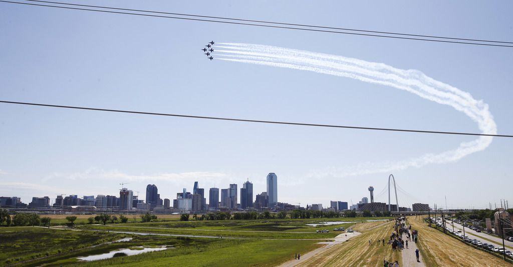 "The U.S. Navy Blue Angels fly over downtown Dallas during the ""America Strong"" flyover event in Dallas on Wednesday, May 6, 2020. The Blue Angels made this flyover as a salute to frontline coronavirus responders."