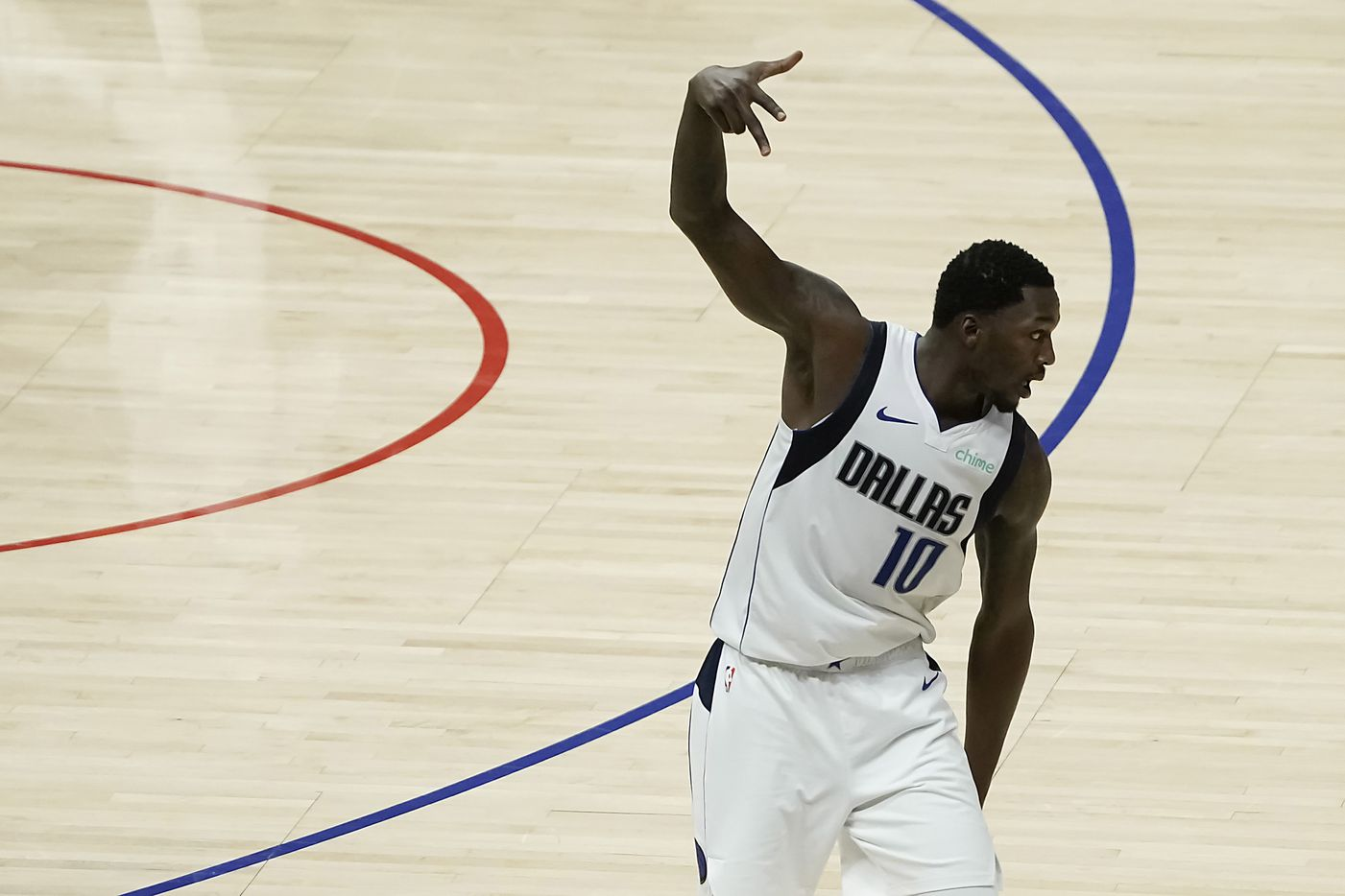 Dallas Mavericks forward Dorian Finney-Smith celebrates after making a 3-pointer during the second half of an NBA playoff basketball game against the LA Clippers at Staples Center on Saturday, May 22, 2021, in Los Angeles. The Mavericks won the game 113-103.