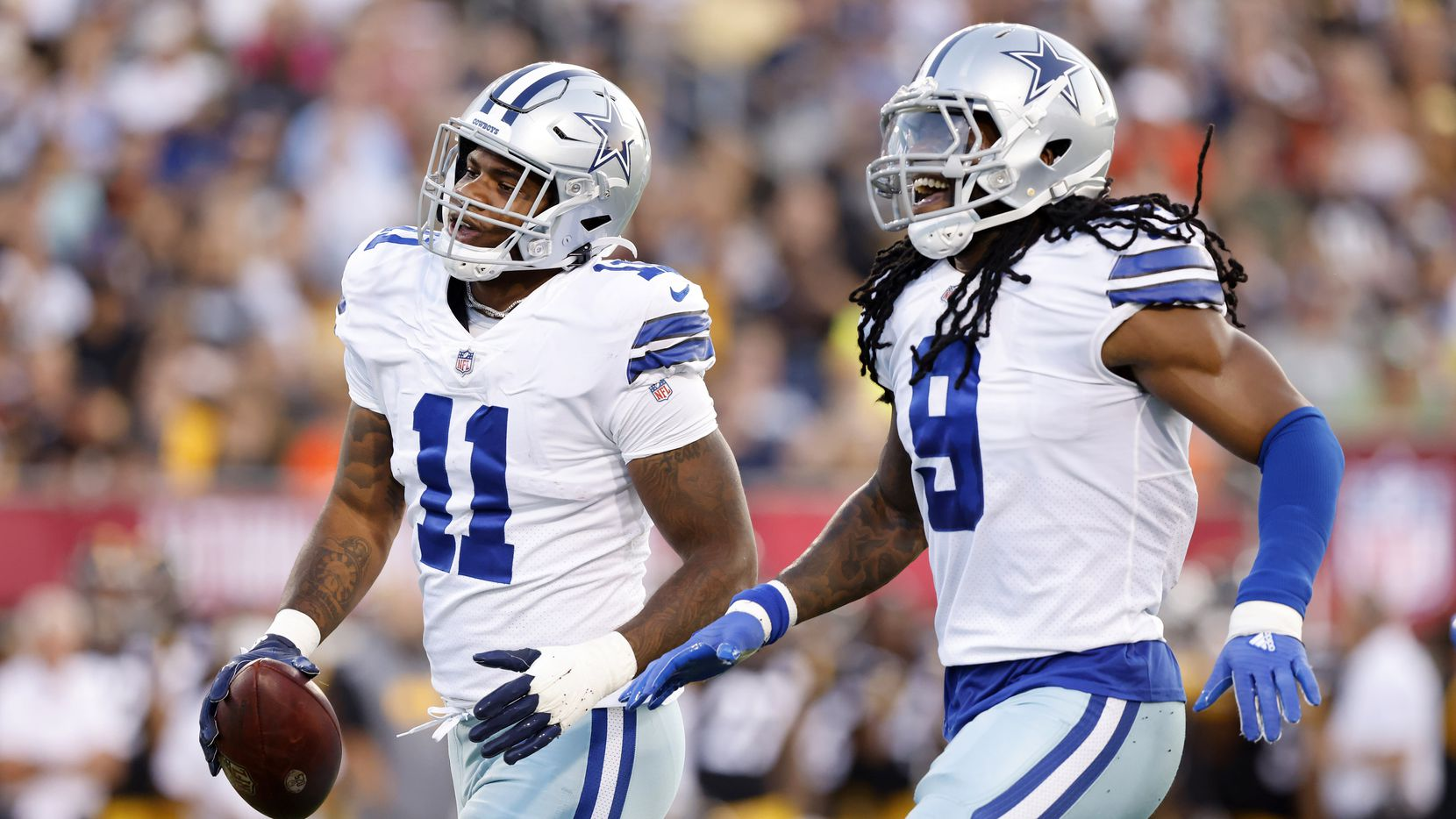 Dallas Cowboys linebacker Micah Parsons (11) celebrates his fumble recovery of Pittsburgh Steelers quarterback Mason Rudolph with teammate Jaylon Smith (9) during the first quarter of their preseason game at Tom Benson Hall of Fame Stadium in Canton, Ohio, Thursday, August 5, 2021.