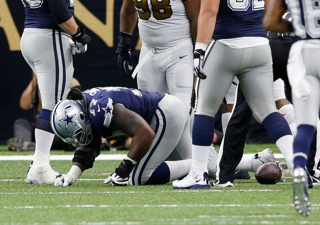 Dallas Cowboys offensive tackle Tyron Smith (77) is slow to get up after getting injured on a play during the second half of play at the Superdome in New Orleans, Louisiana on Sunday, September 29, 2019. New Orleans Saints defeated Dallas Cowboys 12-10. (Vernon Bryant/The Dallas Morning News)