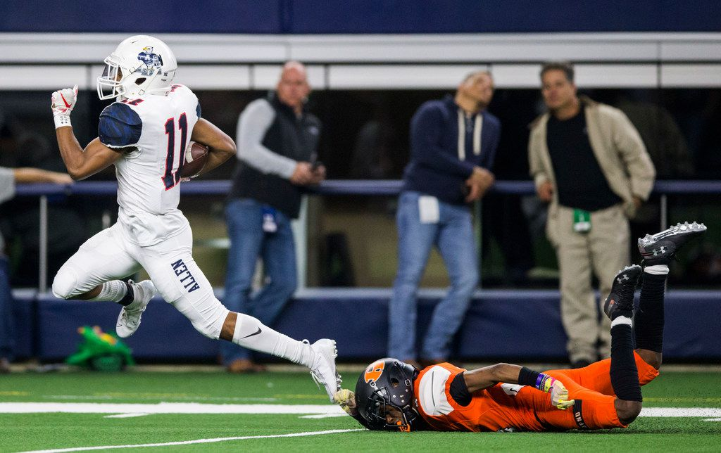 Allen running back Jordan Johnson (11) runs to the end zone for a touchdown ahead of Rockwall defensive back Cyvon Cezar (4) during the third quarter of a Class 6A Division I area-round high school football playoff game between Allen and Rockwall on Friday, November 22, 2019 at AT&T Stadium in Arlington. (Ashley Landis/The Dallas Morning News)