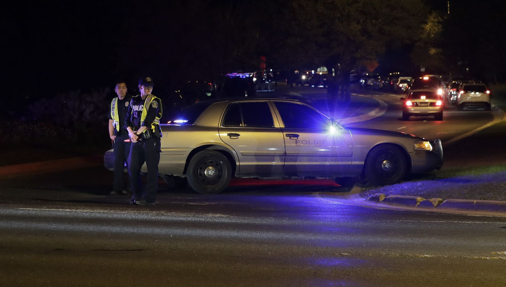Officials man a roadblock near the area of an explosion late Sunday.