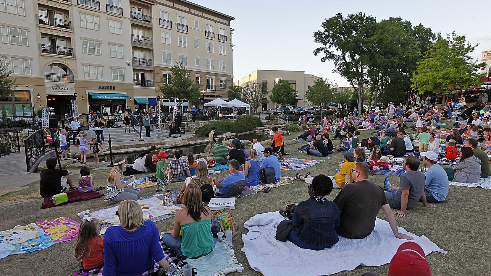A file photo at Watters Creek in Allen on Aug. 24, 2019, shows a large crowd listening to music played by Cover Down in the Concerts by the Creek series.