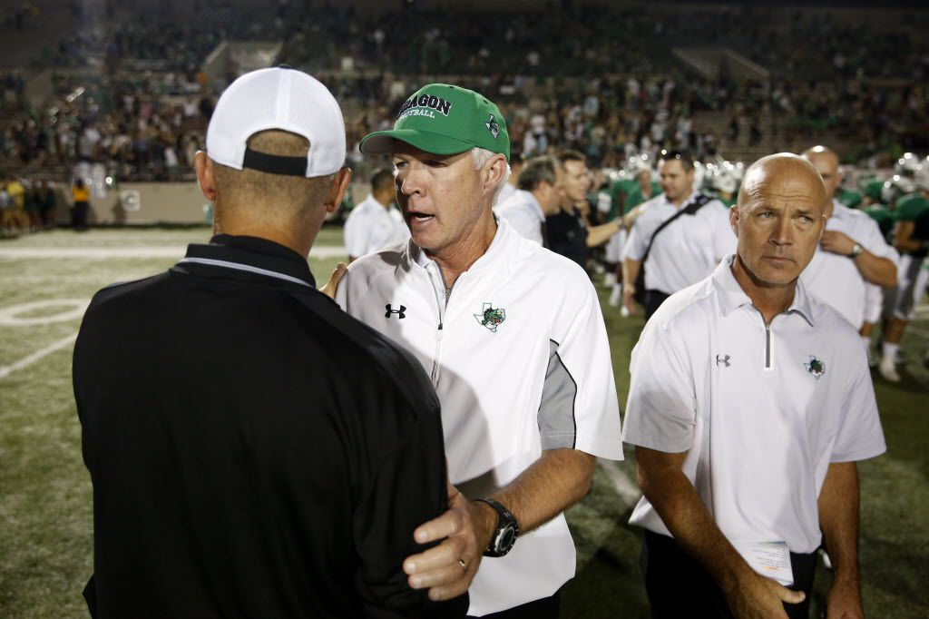Southlake Carroll head coach Hal Wasson greets Abilene  head coach Steve Warren after winning 63-28 during a high school football game between Abilene and Southlake Carroll at Dragon Stadium in Southlake, Texas Friday September 26, 2014. (Andy Jacobsohn/The Dallas Morning News) TXHSFB