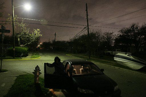 In 2008, Spencer attorney Cheryl Wattley stood in the vicinity of the spot where witnesses claim to have seen Spencer leave a car on the night Young was killed. Witnesses were over 100 feet away; this photo was taken from a distance of 40 feet. Wattley argued that it was impossible for witnesses to positively identify Spencer due to the dim lighting and the distance.