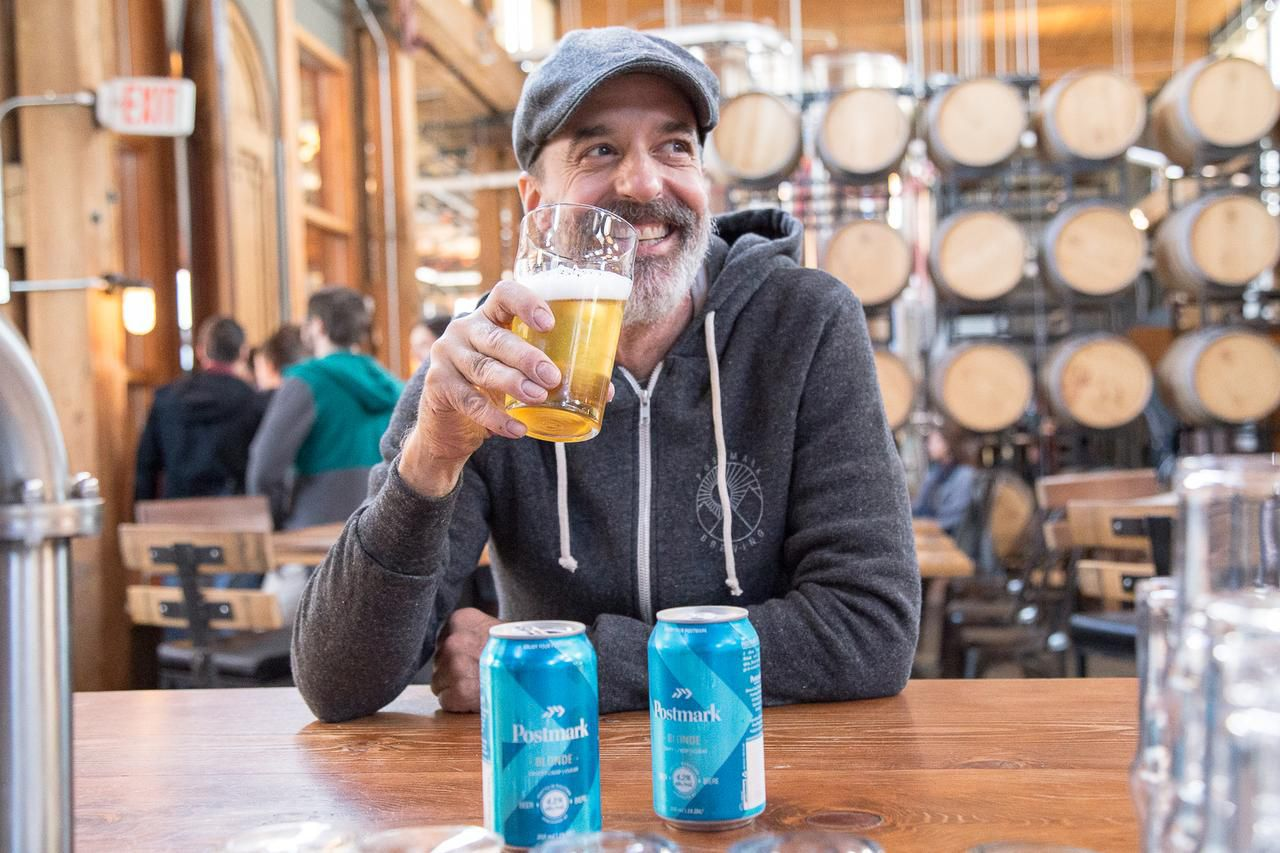 Postmark Brewing's Dominic Giraldes shows off his new blond ale at the brewery, in Vancouver's Railtown district adjacent to Chinatown.