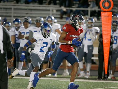 John Paul II WR Jerand Bradley (9) catches a pass and runs for a touchdown as he is chased by Fort Worth Nolan's Devin Thomas (2) during the first half of their TAPPS Division I second-round high school football playoff game in Grapevine, TX, Friday, Nov. 22, 2019.