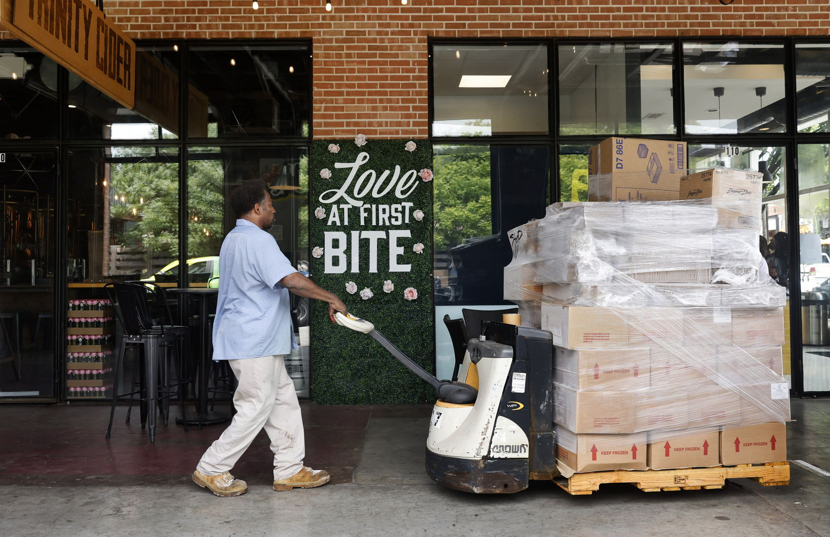 BakeMart driver Ravon Player made a supply delivery to a Deep Ellum ice cream shop in Dallas on July 2, 2021.