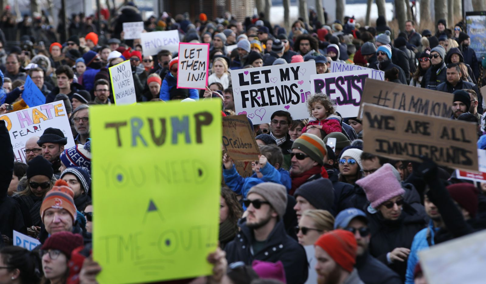 Immigrants' rights' advocates rally in opposition to President Donald Trump's immigration order, Sunday, Jan. 29, 2017, in New York. Some travelers were detained at airports, while panicked families searched for relatives as protesters such as these registered opposition to the president's sweeping measure that was blocked by several federal courts. (AP Photo/Kathy Willens)