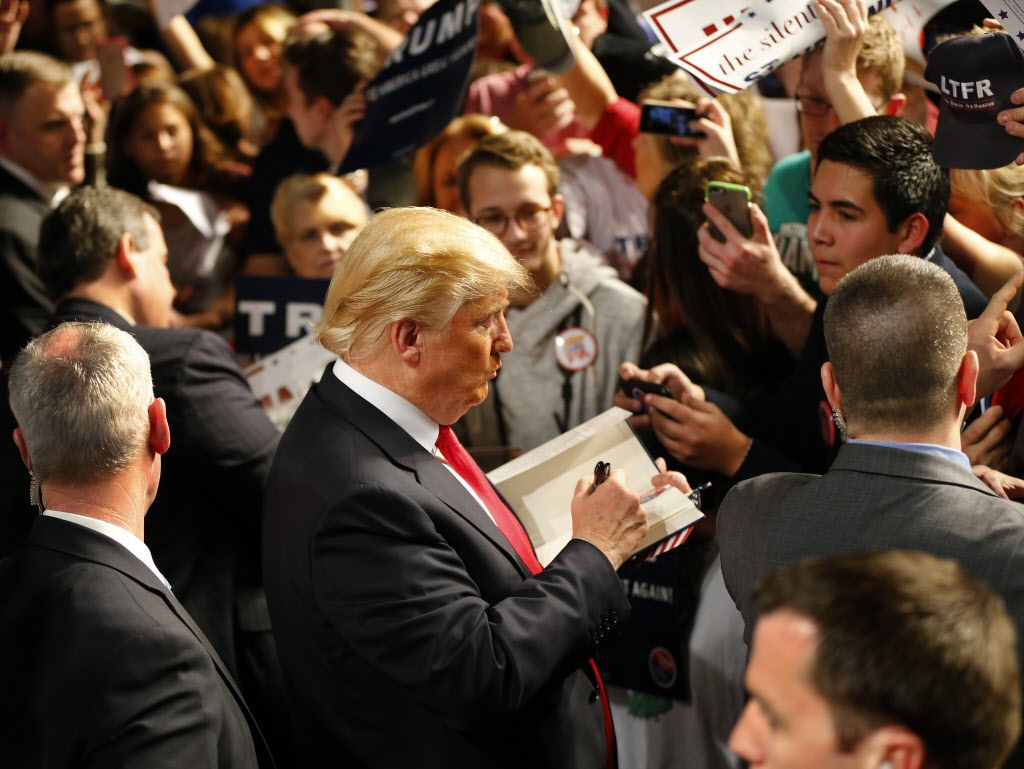 Then-Republican presidential candidate Donald Trump signed a book for a supporter after a rally at the Fort Worth Convention Center in February 2016.