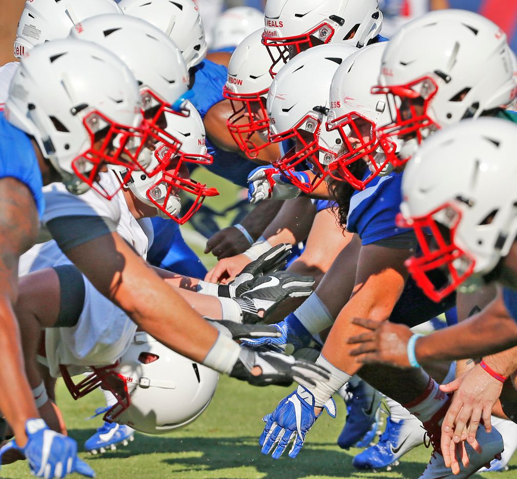 The SMU offensive and defensive lines tangle during SMU football practice on campus in Dallas on Saturday, August 4, 2018. (Louis DeLuca/The Dallas Morning News)
