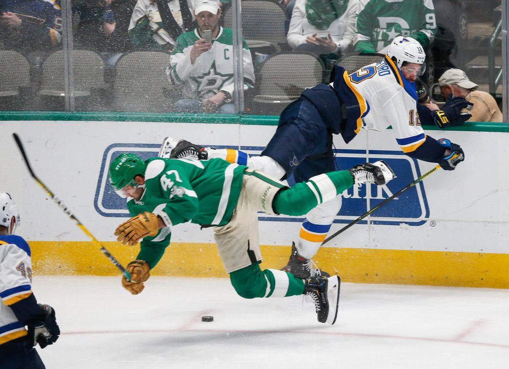 Dallas Stars right wing Alexander Radulov (47) is upended by St. Louis Blues left wing Zach Sanford (12) while battling for control during the third period of an NHL matchup between the Dallas Stars and the St. Louis Blues on Friday, Feb. 21, 2020 at American Airlines Center in Dallas. (Ryan Michalesko/The Dallas Morning News)