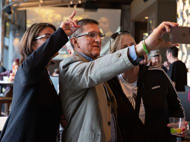 """Former national security adviser Michael Flynn snaps a selfie at the Omni Hotel in Dallas during the """"For God & Country Patriot Roundup"""" on Friday, May 28, 2021."""