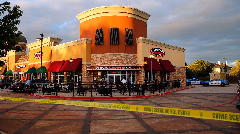 Arlington police investigate a shooting in which two people were found dead at the Zona Caliente Sports Bar and Grill on S. Cooper St. in Arlington, Wednesday, May 3, 2017. The shooting suspect walked to the end of the bar and shot an employee he was talking to. Seeing the this happen, a diner got up and shot the suspect dead.  There were 15-20 people at the bar and handful of employees in the restaurant.  (Tom Fox/The Dallas Morning News)