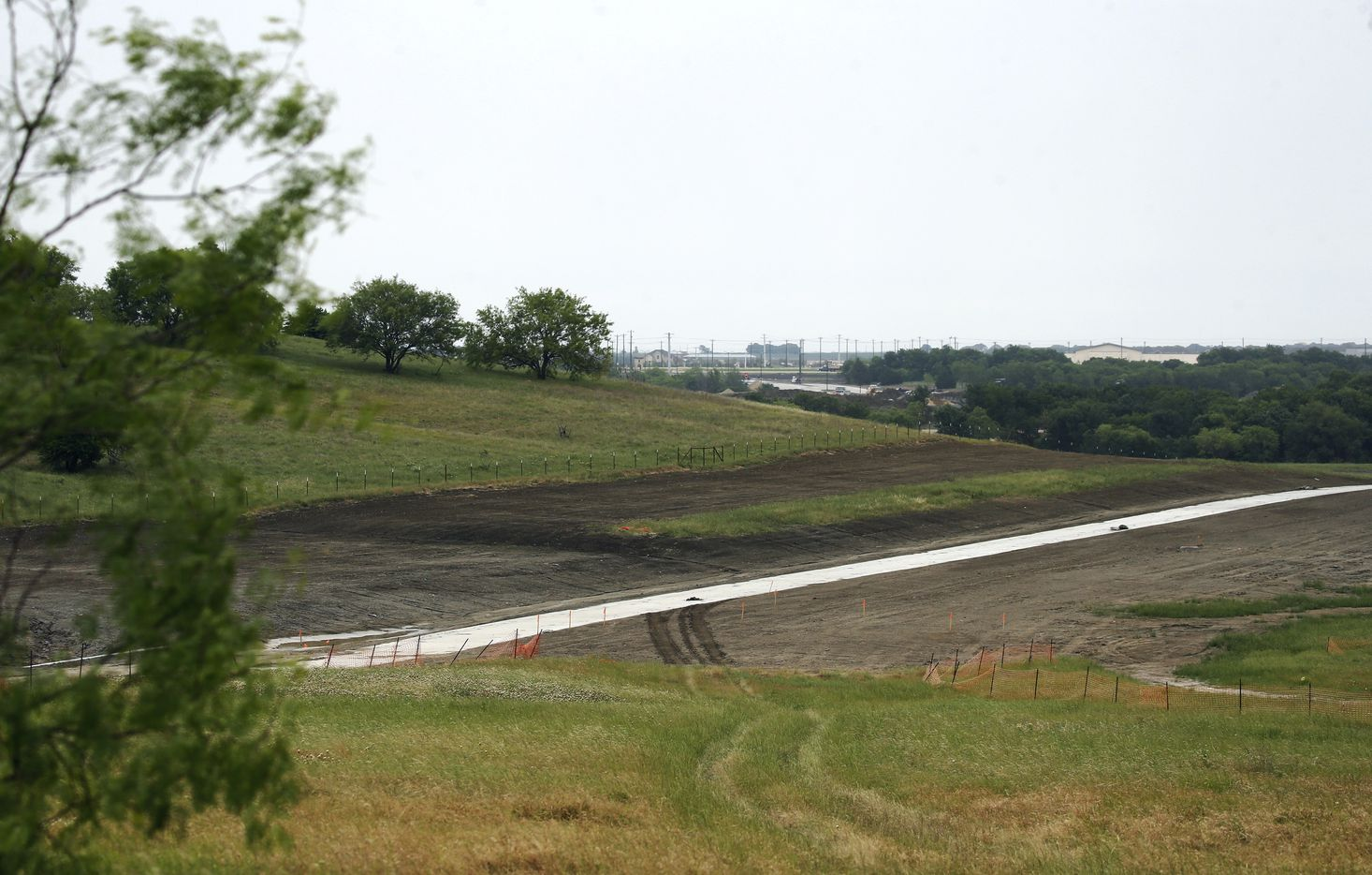 View of part of the 8-mile concrete path that will be used during tournaments at PGA Frisco in Frisco, Texas, on Wednesday, May 20, 2020. The path will also be open to the public as part of Frisco's hike and bike trail when tournaments are not at play. The $520 million project is a mixed-use development that will be home to the PGA of America headquarters and two championship golf courses.