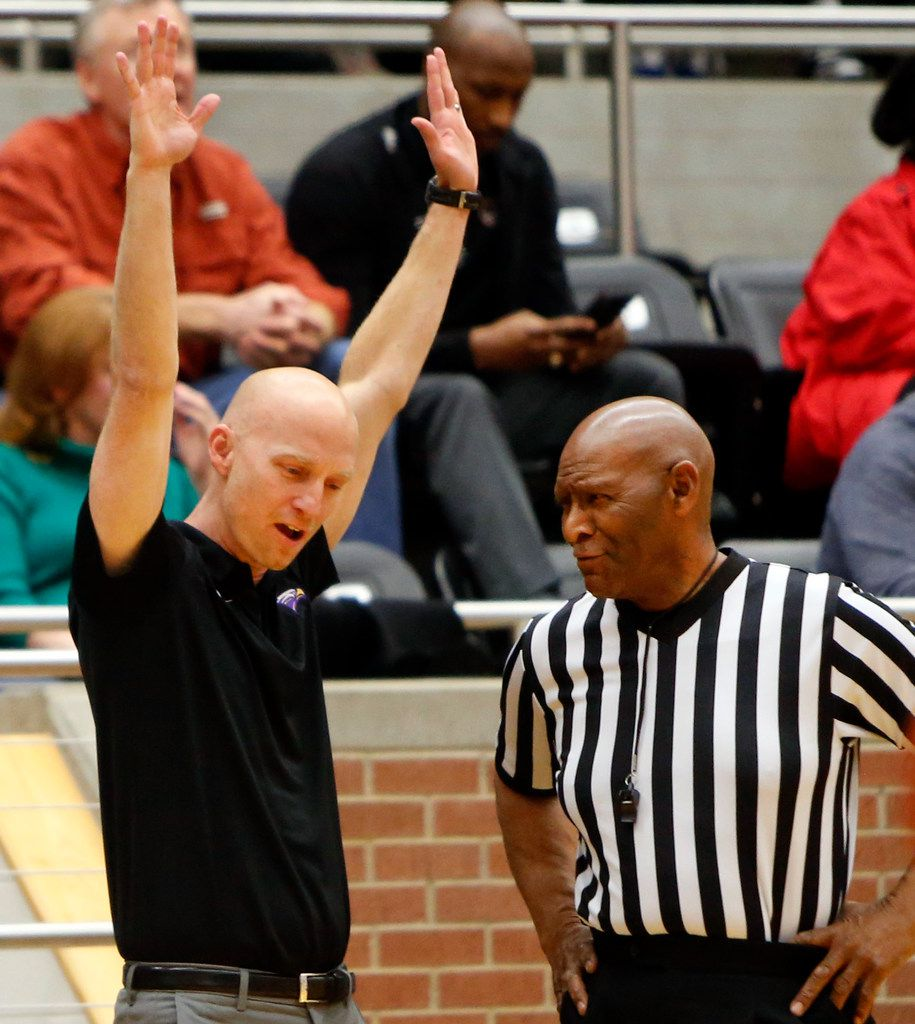 Richardson head coach Kevin Lawson questions a game official about a defensive foul called against his team during first half action against DeSoto. Richardson defeated DeSoto 63-51 to advance. The two teams played their Class 6A boys bi-district playoff basketball game at Forney High School in Forney on February 24 2020. (Steve Hamm/Special Contributor).
