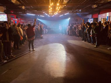 Members of the crowd follow Dan Deacon's directions during his concert at Deep Ellum Art Co. on Sunday, March 8 in Dallas, Texas.