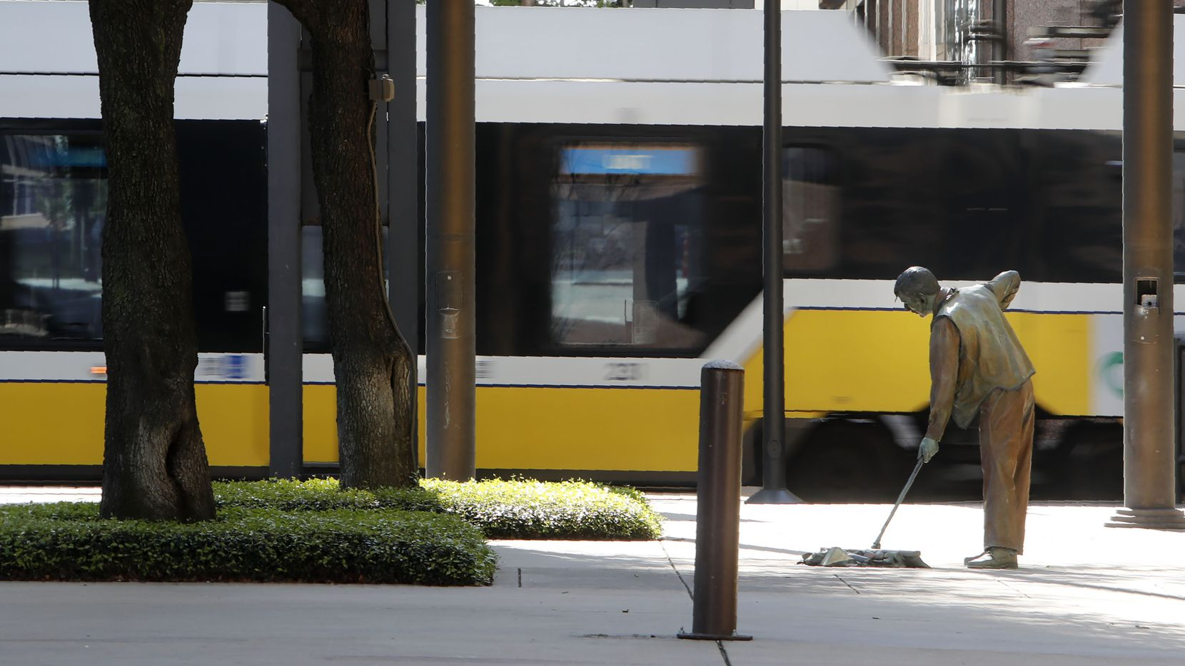 With Dallas County under a shelter in place order due to the coronavirus, a normally busy train stop sits empty in downtown Dallas, Tuesday, March 24, 2020. (AP Photo/LM Otero)