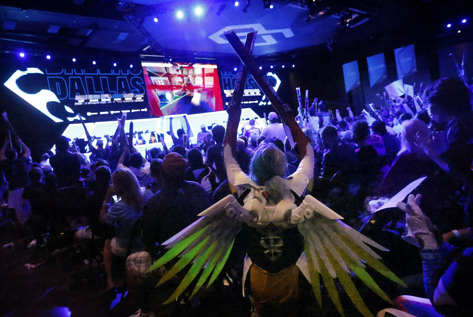 Dallas Fuel fan Hope Hopkins of Alvarado, Texas came dressed as Mercy, a character from Overwatch League. She another fans cheered as the Fuel won a map during their match against the Houston Outlaws at Esports Stadium Arlington Friday, July 9, 2021. Dallas Fuel defeated Houston in The Battle for Texas, 3-0. It was the first in-person live competition for fans in over a year. Houston competed from their hometown. (Tom Fox/The Dallas Morning News)