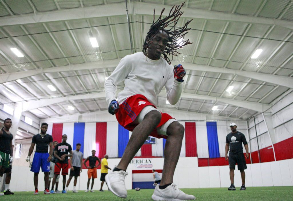 Mesquite High School defensive back Antonio Taylor, 17, works on his foot technique with defensive back football trainer Clay Mack, right, during a training session with high school and college football players, on Tuesday, July 12, 2016 at American Indoor Sports in Carrollton. Ben Torres/Special Contributor