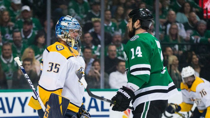 Dallas Stars left wing Jamie Benn (14) tries to distract Nashville Predators goaltender Pekka Rinne (35) at the goal during the first period of Game 6 of the first round of Stanley Cup Playoffs between the Dallas Stars and the Nashville Predators on Monday, April 22, 2019 at American Airlines Center in Dallas.