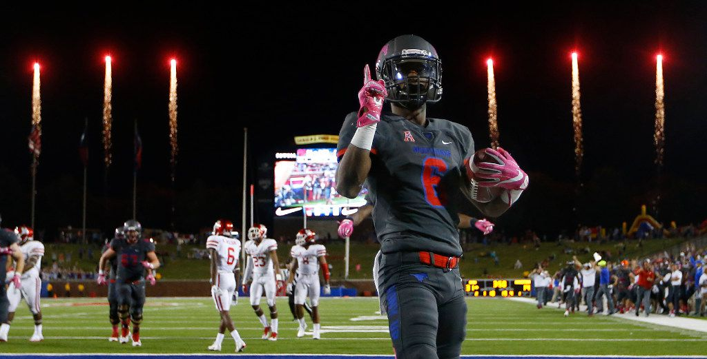 Southern Methodist Mustangs running back Braeden West (6) scores the final touchdown in the fourth quarter as the fireworks go off at Gerald J. Ford Stadium in University Park, Texas, Saturday, October 22, 2016. SMU upset the Houston Cougars, 38-16.  (Tom Fox/The Dallas Morning News)
